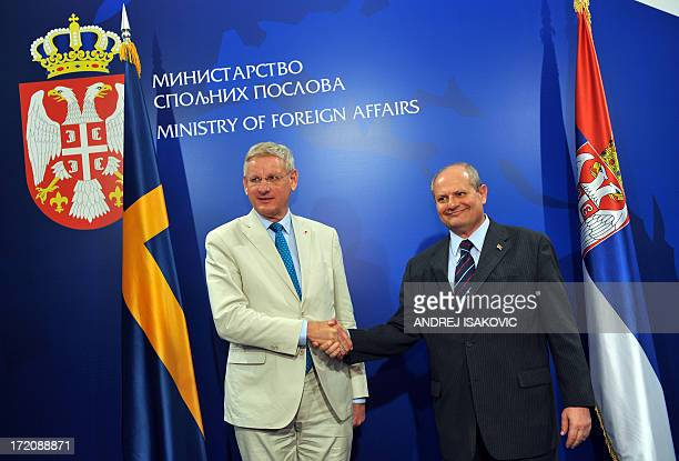 Serbian Minister of Foreign Affairs Ivan Mrkic shakes hands with his Swedish counterpart Carl Bildt prior to their meeting in Belgrade on July 1 2013...