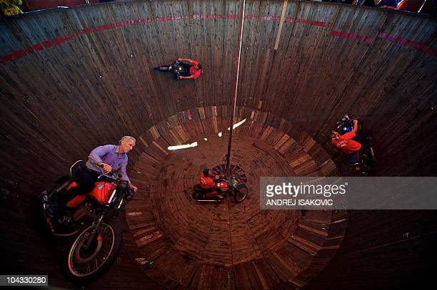Serbian motorcyclists ride inside of the 'Wall of Death' during a public fair in Sabac 100km west of capital Belgrade on September 21 2010 The Wall...