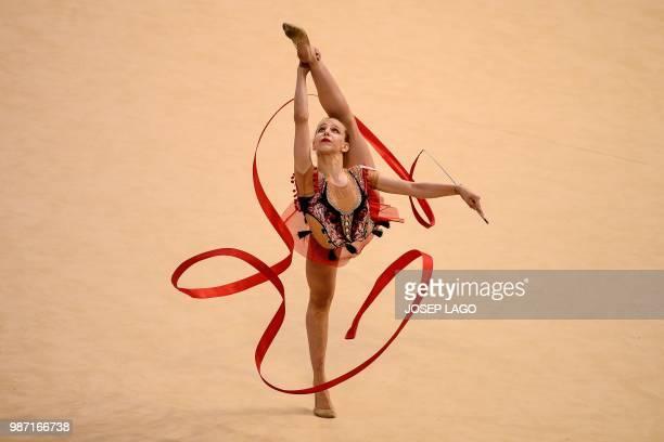 Serbian Nastasija Gvozdic competes during the women's rhythmic gymnastics individual qualification at the XVIII Mediterranean Games in Reus near to...