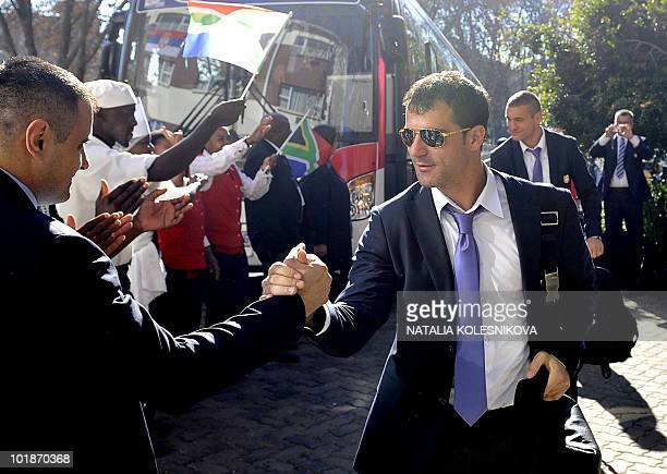 Serbian national football team midfielder Dejan Stankovic is greeted by a supporter on his team's arrival in Johannesburg, on June 8, 2010 ahead of...