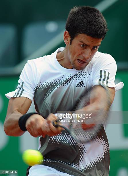 Serbian Novak Djokovic returns a backhand to Belgian Steve Darcis during their WTA Tennis Open in Rome on May 7, 2008. Diokovic won 6-4, 6-0. AFP...