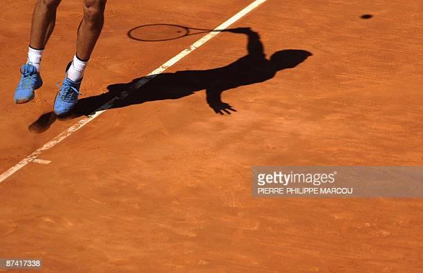 Serbian Novak Djokovic returns the ball against Spanish Rafael Nadal during their semi final match of the ATP Madrid Open claycourt tournament...