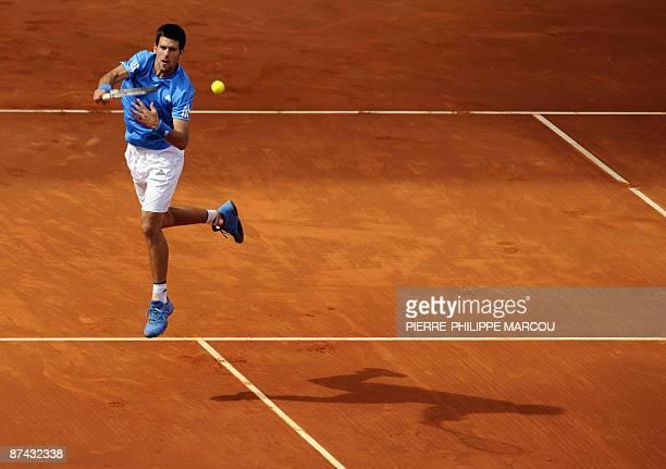 Serbian Novak Djokovic returns the ball against Spanish Rafael Nadal during his semi final match of the ATP Madrid Open claycourt tournament on May...