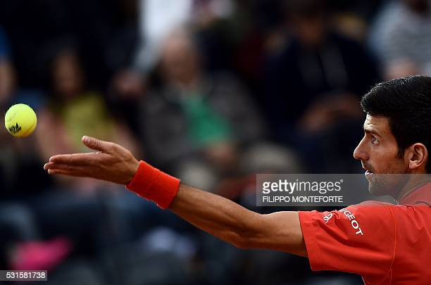 TOPSHOT Serbian Novak Djokovic serves the ball to Andy Murray of Great Britain during the final match of the ATP Tennis Open tournament game at the...