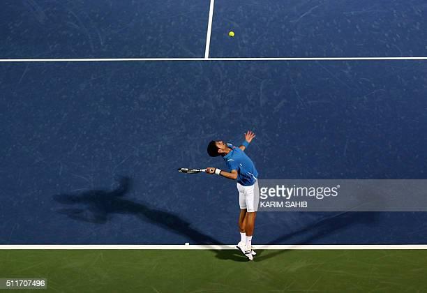 TOPSHOT Serbian Novak Djokovic serves the ball to Spanish Tommy Robredo during their ATP tennis match on the first round of the Dubai Duty Free...