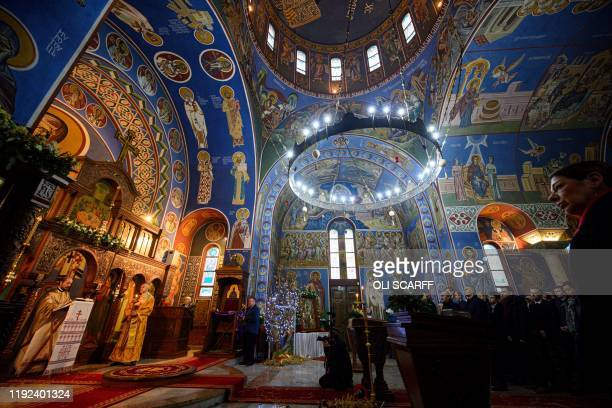 Serbian Orthodox Christian priest Father Nenad Popovic leads worshippers during a service of the Nativity of Christ Liturgy at the Serbian Orthodox...