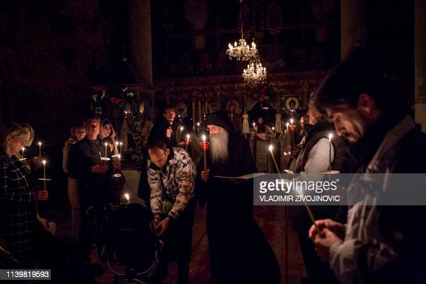 Serbian Orthodox Christians attend a midnight Easter service at Sukovo Monastery in Sukovo near the town of Pirot early on April 28 2019