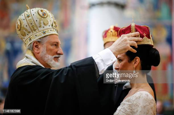 Serbian Orthodox Church Bishop Irinej performs the wedding ceremony of Prince Dushan and his bride Valerie De Muzio at Oplenac church on May 25 2019...