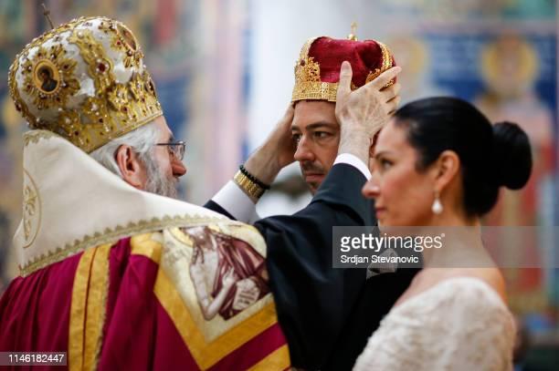 Serbian Orthodox Church Bishop Jovan of Sumadija performs the wedding ceremony of Prince Dushan and his bride Valerie De Muzio at Oplenac church on...