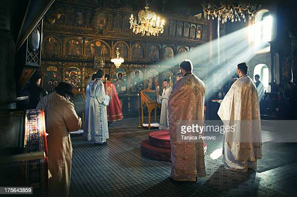 CONTENT] Serbian Orthodox priests in vestments deacons and faithful people during Holy Liturgy Great Entrance in Nativity churchPirot with sunlight...