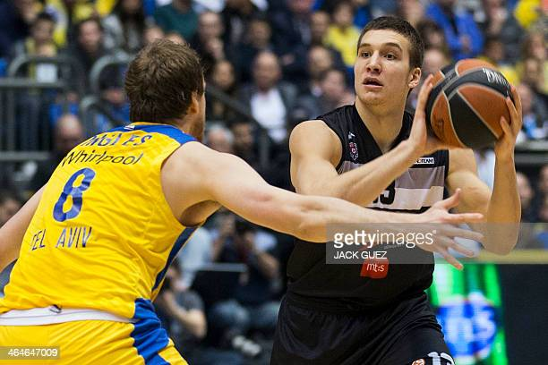 Serbian Partizan Nis Belgrade's guard Bogdan Bogdanovic is guarded by Israel Maccabi Electra Tel Aviv's forward Joe Ingles during their Euroleague...