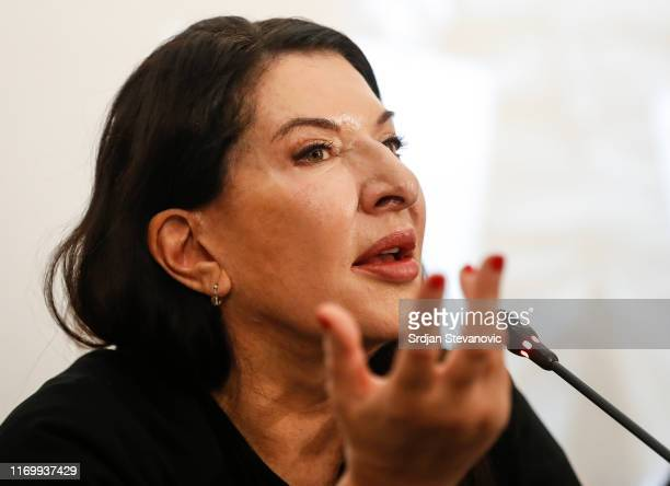 Serbian performance artist Marina Abramovic poses for the photographers during the presentation for the media of her exhibition 'The Cleaner' at the...