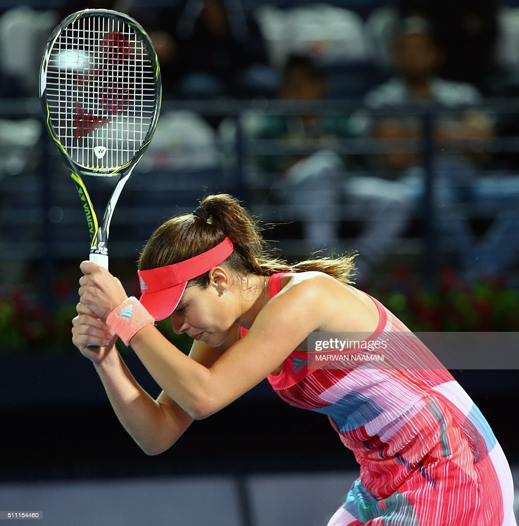 Serbian player Ana Ivanovic reacts after losing a point against Czech player Barbora Strycova during their quarter-final WTA game as part of the Dubai Duty Free Tennis Championships, on February 18, 2016. / AFP / MARWAN