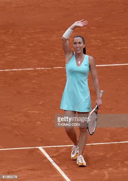 Serbian player Jelena Jankovic celebrates after winning against Spanish player Carla Suarez Navarro during their French tennis Open quarter final...