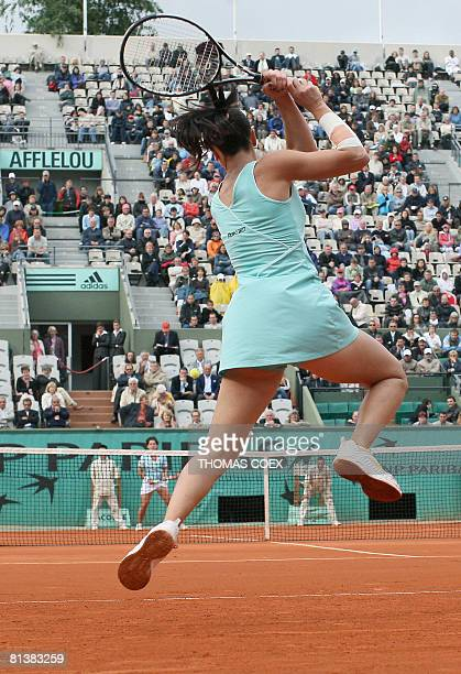 Serbian player Jelena Jankovic hits a return to Spanish player Carla Suarez Navarro during their French tennis Open quarter final match at Roland...