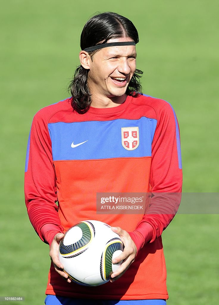 Serbian player Marko Pantelic makes a joke with his teammates in the local stadium of Leogang, Austria on May 25, 2010 prior to the first training session of the Serbian team in their training camp to prepare for the 2010 World Cup in South Africa.