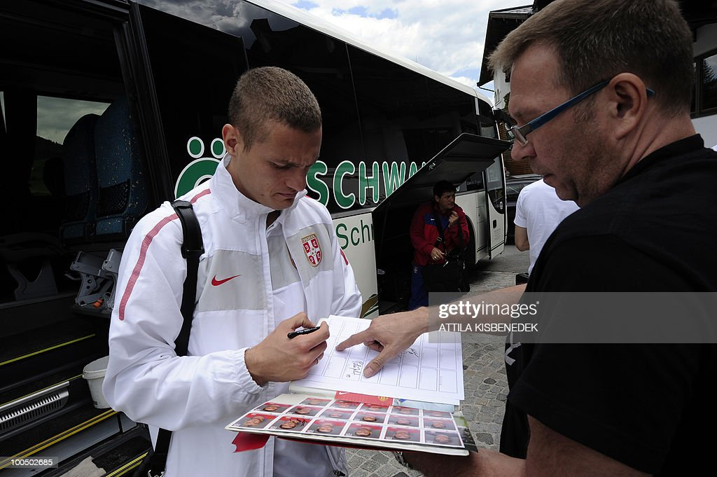 Serbian player Nemanja Vidic of Manchester United signs an autograph to a supporter as their national soccer team arrives at the Hotel Krallerhof in Leogang, Austria on May 25, 2010 where the Serbian team is staying while holding a training camp to prepare for the 2010 World Cup in South Africa.