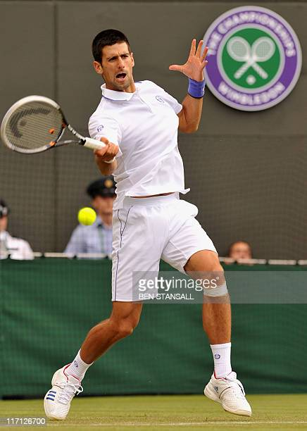 Serbian player Novak Djokovic plays against South Africa's Kevin Andersen in a Men's Singles match at the 2011 Wimbledon Tennis Championships at the...