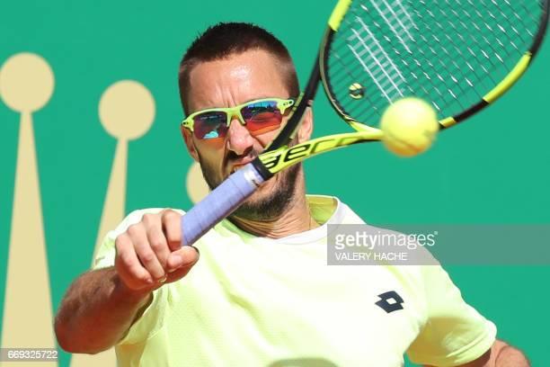 Serbian player Viktor Troicki hits a return to Uruguayan Pablo Cuevas during the MonteCarlo ATP Masters Series Tournament tennis match on April 17...