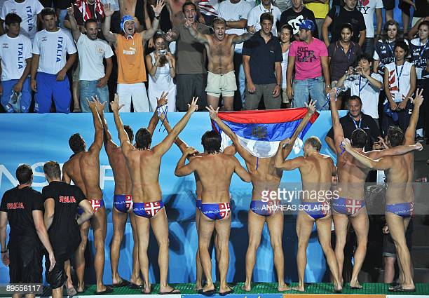 Serbian players celebrate after beating Spain at the end of the Men's waterpolo GoldMedal match on August 1 2009 at the FINA World Swimming...