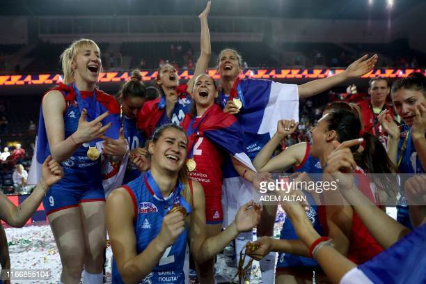 Serbian players celebrate after winning the 2019 Women's European Volleyball Championship final match between Turkey and Serbia at the Ankara Sports...