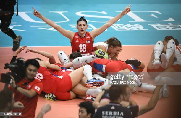 Serbian players celebrate their victory following the 2018 FIVB World Championship volleyball women's final match between Italy and Serbia in...