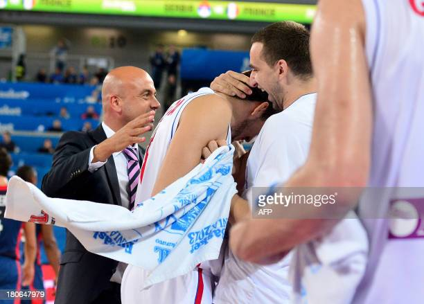 Serbian players react after scoring during the FIBA European basketball championship second round match between Serbia and France in Ljubljana...