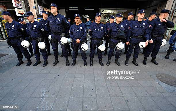 Serbian policemen stand guard at the entrance to a conference hall in Belgrade on October 6, 2012. Serbia's gay activists vowed on Saturday to keep...