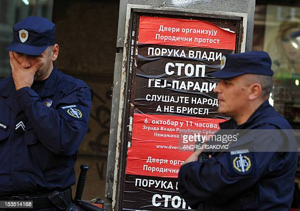 Serbian policemen stand guard at the entrance to a conference hall in central Belgrade on October 6, 2012. Serbia's gay activists vowed today to keep...