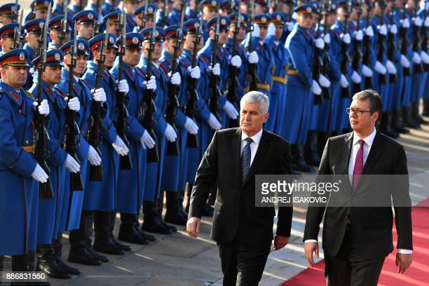 Serbian President Aleksandar Vucic and Bosnia and Herzegovina Presidency Chairman Dragan Covic review a guard of honor prior their meeting in...