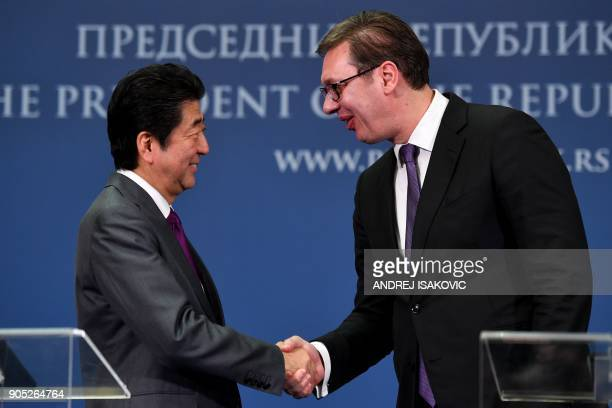 Serbian President Aleksandar Vucic and Japanese Prime Minister Shinzo Abe shake hands during a joint press conference after their meeting in Belgrade...