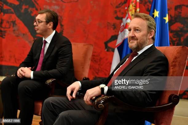 Serbian President Aleksandar Vucic and member of Bosnia and Herzegovina's tripartite Presidency Bakir Izetbegovic take part in a meeting in Belgrade...