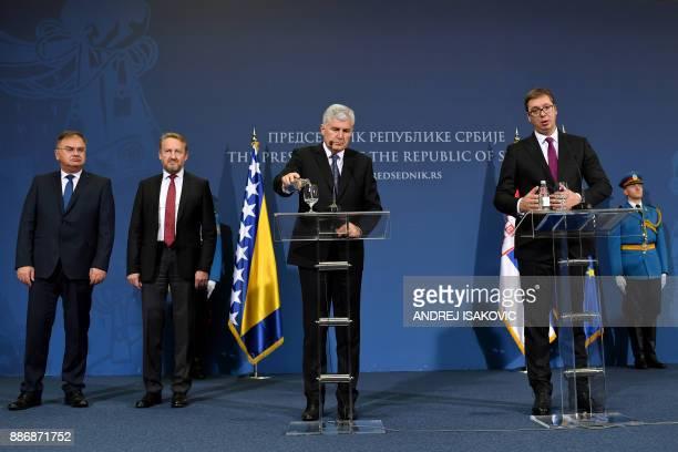 Serbian President Aleksandar Vucic and members of Bosnia and Herzegovina's tripartite Presidency Bakir Izetbegovic Dragan Covic and Mladen Ivanic...