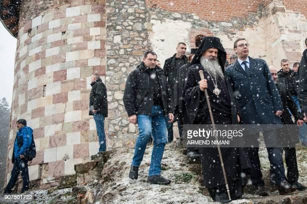 Serbian President Aleksandar Vucic next to Serbian Orthodx Bishop Teodosije visits the Banjska Monastery in northern Mitrovica on January 20 2018 /...