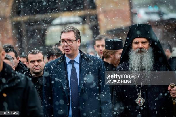 Serbian President Aleksandar Vucic next to Serbian Orthodx Bishop Teodosije arrives at the Banjska Monastery in northern Mitrovica on January 20 2018...