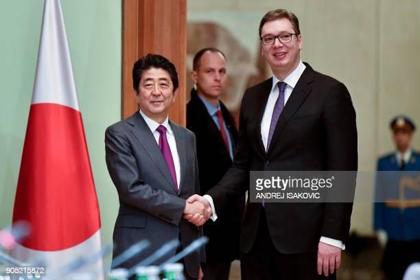 Serbian President Aleksandar Vucic shakes hands with Japanese Prime Minister Shinzo Abe during their meeting in Belgrade on January 15 2018 Japanese...