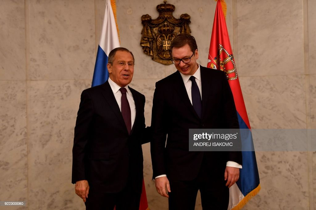 Serbian President Aleksandar Vucic (R) welcomes Russian Foreign Minister Sergei Lavrov ahead of their meeting in Belgrade on February 21, 2018. Russian Foreign Minister Sergei Lavrov is visiting Belgrade on the 180th anniversary of the establishment of diplomatic relations between Russia and Serbia. /