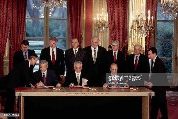 Serbian President Slobodan Milosevic Croat President Franjo Tudjman and Bosnian President Alija Izetbegovic sign multiple copies of the Dayton Peace...