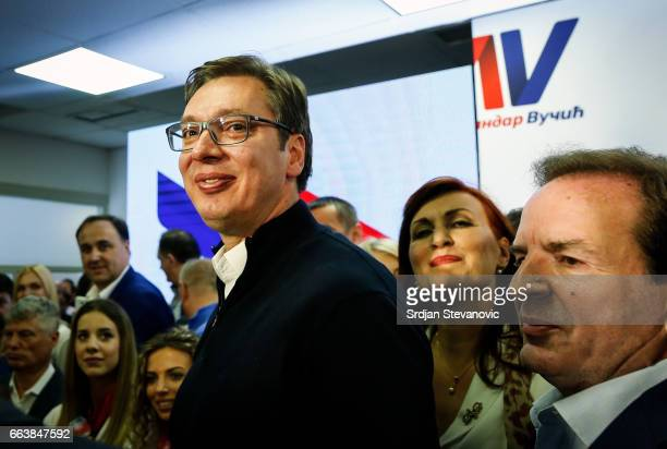 Serbian Presidentelect Aleksandar Vucic celebrates with Bogoljub Karic after declaring a victory on April 2 2017 in Belgrade Serbia According to the...
