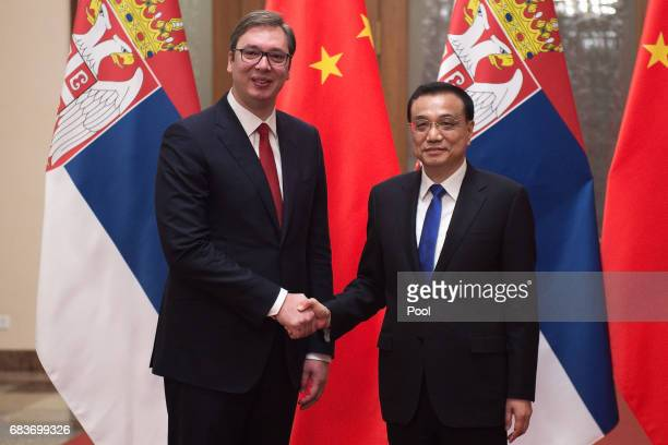 Serbian Prime Minister Aleksandar Vucic shake hands with Chinese Premier Li Keqiang at the Great Halll of the People in Beijing on May 16 2017
