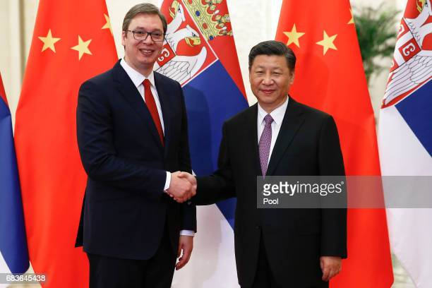 Serbian Prime Minister Aleksandar Vucic shakes hands with Chinese President Xi Jinping as they meet at the Great Hall of the People on May 16 2017 in...