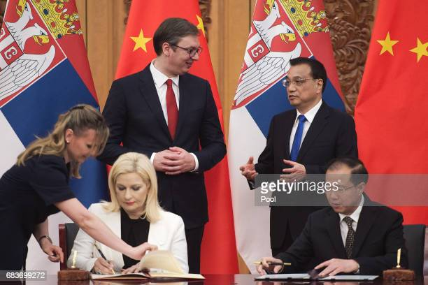 Serbian Prime Minister Aleksandar Vucic talks with Chinese Premier Li Keqiang during a signing ceremony at the Great Halll of the People in Beijing...