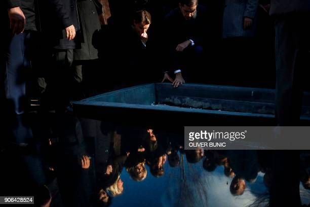 Serbian Prime Minister Ana Brnabic mourns next to the grave of late Kosovo Serb politician Oliver Ivanovic during his funeral ceremony at the...