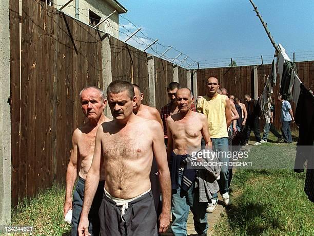 Serbian prisoners of war walk 21 August 1992 around the yard of a Bosnian military prison in Sarajevo