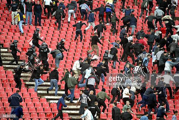 Serbian riot police clash with Partizan soccer fans during the National Cup semi final match Red Star vs Partizan in Belgrade 21 April 2004 Red Star...