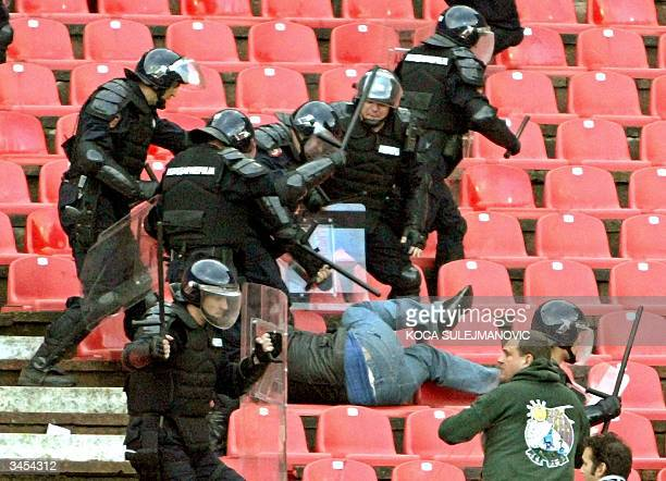 Serbian riot police clash with soccer fans during the National Cup semi final match Red Star vs Partizan in Belgrade 21 April 2004 Red Star won 10...
