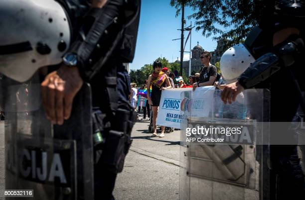 Serbian riot police officers patrol during the Gay Pride parade on June 24 2017 in Belgrade The march was held without incidents amid tight security...