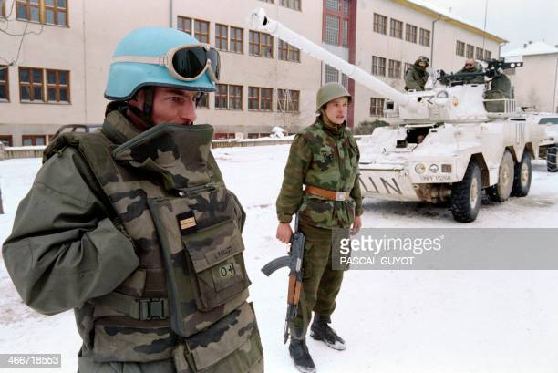 A Serbian soldier looks at a French UNPROFOR soldier at Lukavica barracks Sarajevo on February 15 1994 five days before the term of NATO ultimatum...