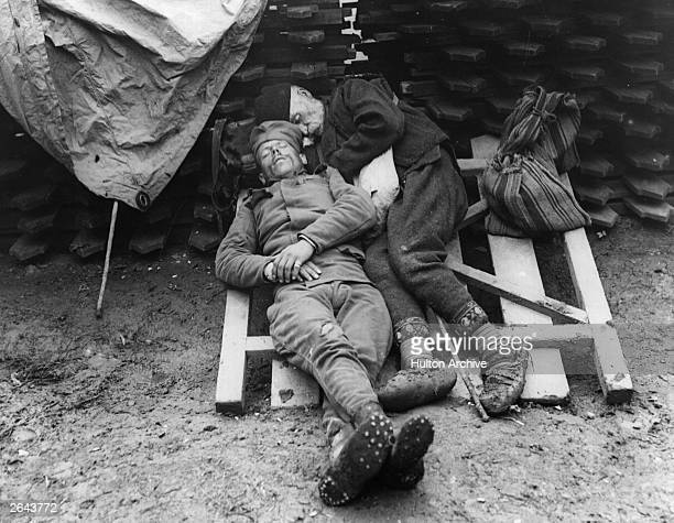 Serbian soldiers rest after duty in the trenches near Belgrade