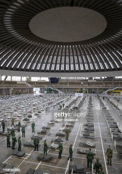 Serbian soldiers set up beds for treatment of possible COVID-19 infected patients inside of the Belgrade Fair on March 24, 2020 in Belgrade, Serbia....